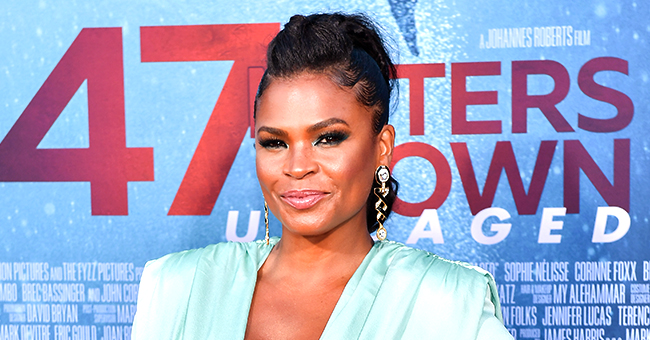 Nia Long Rocks Plunging Aqua Minidress & Tousled Ponytail for '47 Meters Down: Uncaged' Premiere