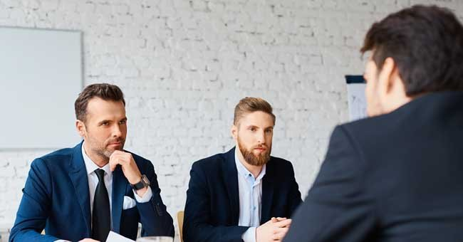 Photo of two men during a job interview | Photo: Shutterstock.com