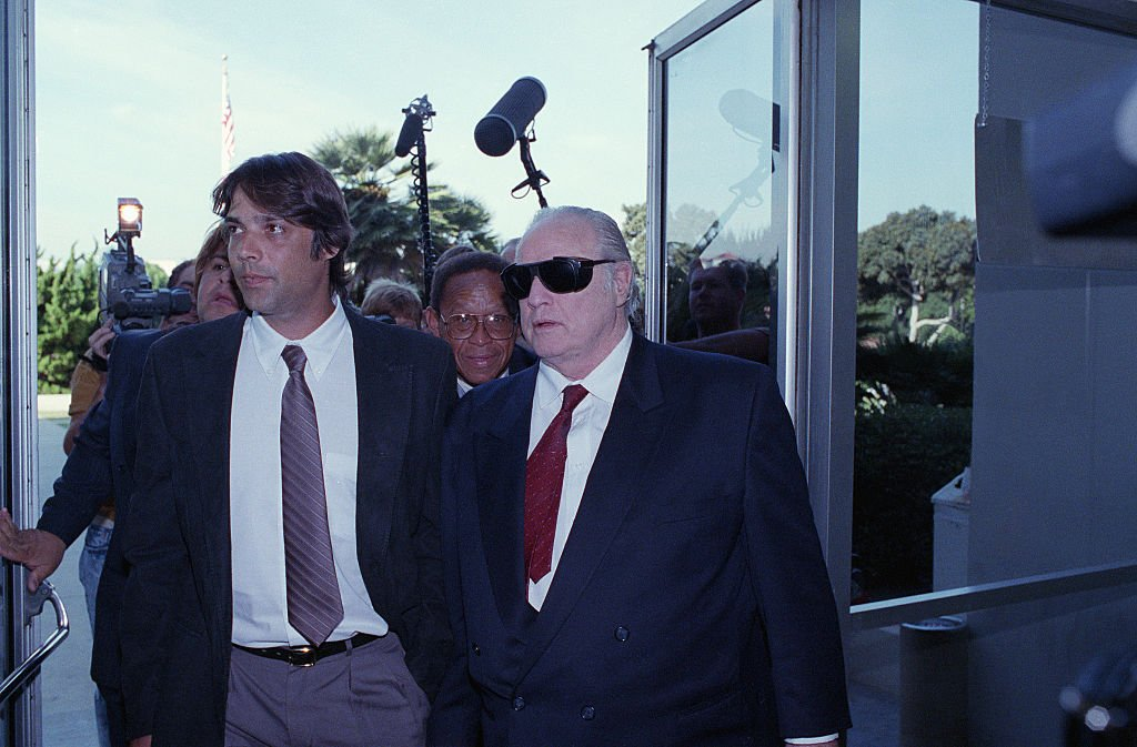 Actor Marlon Brando (R), accompanies his son, Christian (L), into Superior Court for a pre-trial hearing on charges that Christian Brando murdered his half-sister's lover on September 26, 1990   Photo: Getty Images