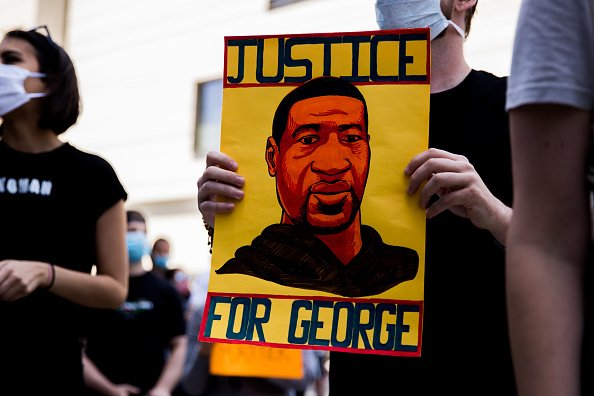 A protester holds a sign commemorating George Floyd during the march to support Black Lives Matter protests on June 06, 2020 in Beverly Hills, California   Source: Photo: Getty Images