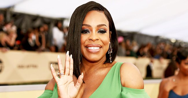 Niecy Nash Sets Hearts Racing on a Yacht Showing Her Long Legs in a Versace Swimsuit & Pareo