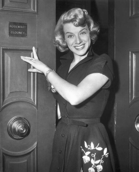 Rosemary Clooney points to her nameplate on the exterior of a door in this 1945 photograph. | Source: Getty Images.