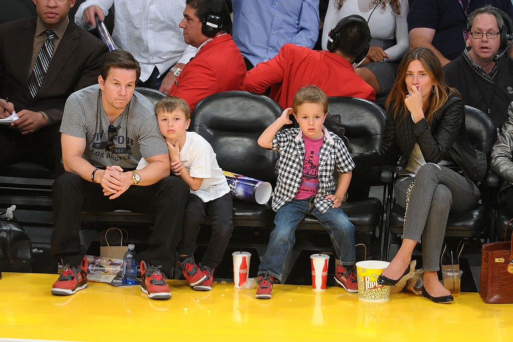 Mark Walberg with his sons and wife Rhea Durham watch the New York Knicks play the Los Angeles Lakers in 2014 in Los Angeles | Source: Getty Images