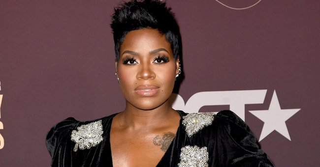 Pregnant Fantasia's Son Dallas Looks Cool in Slippers Helping Her Choose a Baby Chair in a Shop
