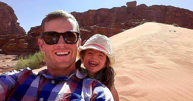 Chris Brannigan smiles with his daughter Hasti before a scenic view. | Source: Twitter.com/People