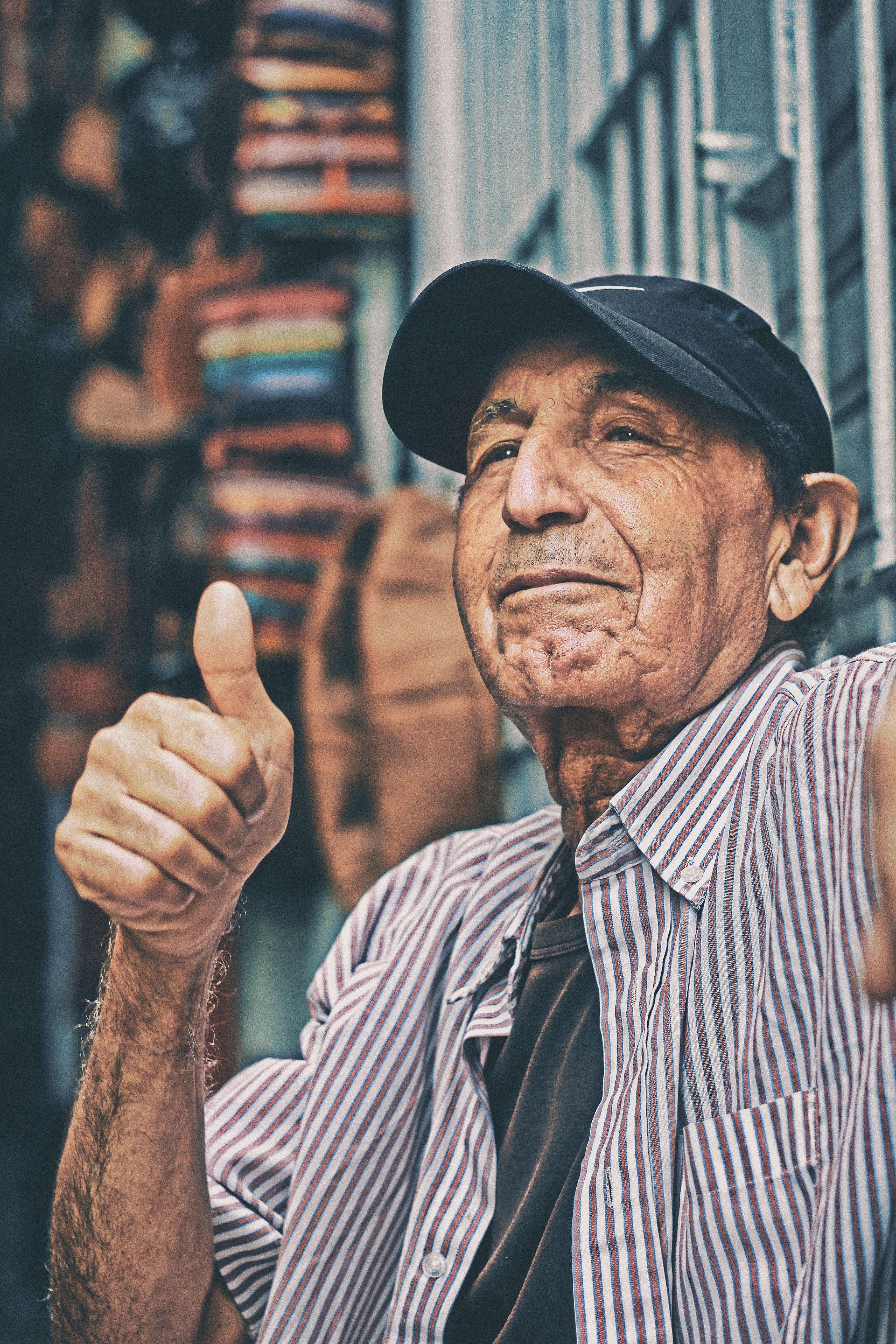 An old man giving a thumbs up. Source: Unsplash