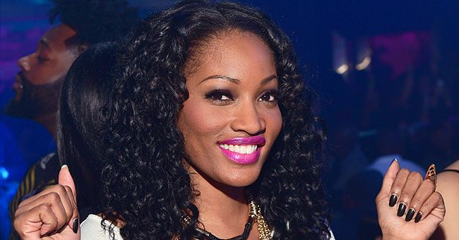 Erica Dixon Looks Pretty in Pink as She Poses in Front of a Black Car (Photo)