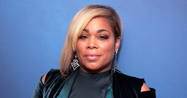 T-Boz's Daughter Chase Shows Her Beautiful Brown Eyes & Curly Hair Posing In a Car in a Purple Top