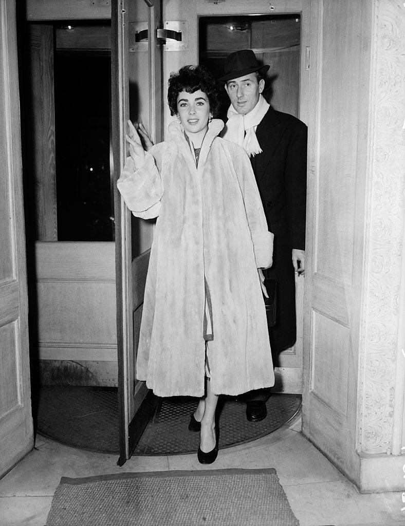 Elizabeth Taylor with her husband Michael Wilding (1912 - 1979) the day before their wedding at Caxton Hall. | Getty Images