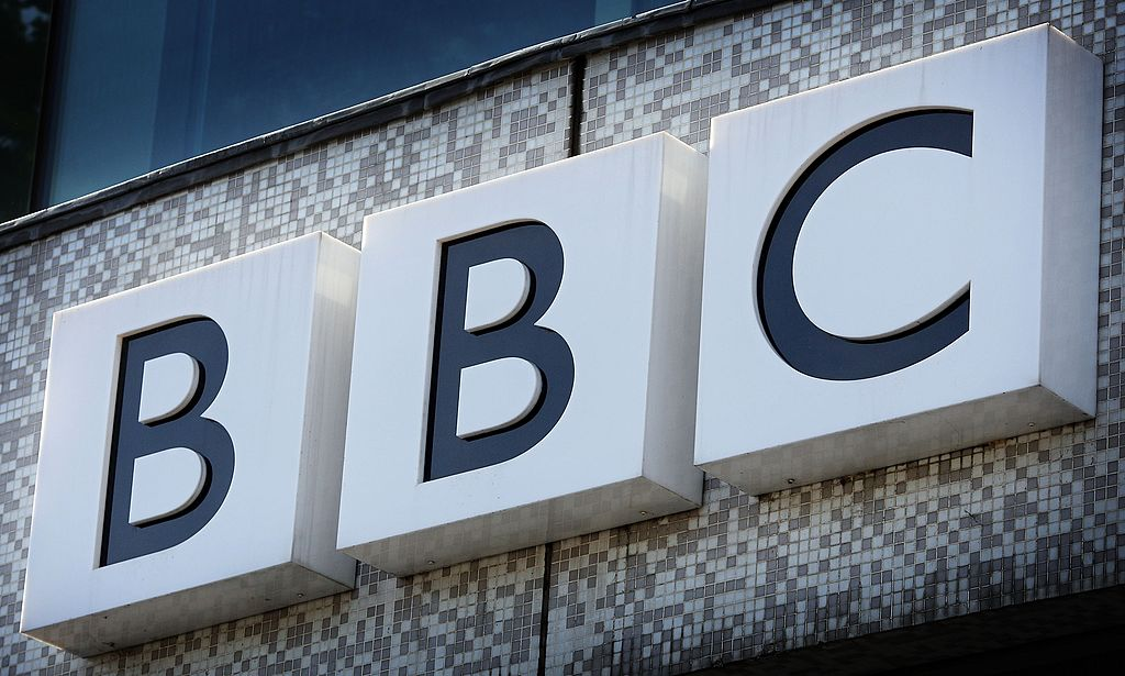 The BBC logo is displayed above the main entrance to Television Centre on October 18, 2007 in London, England. | Photo: Getty Images