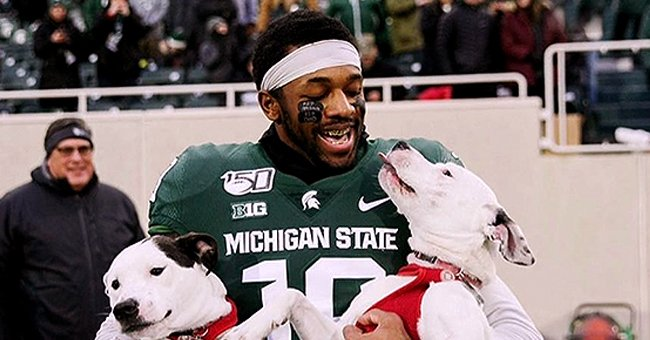 Josh Butler from Michigan State Adopted Two Dogs to Cope with Losing Both of His Parents and Walked on the Field with Them for Senior Day