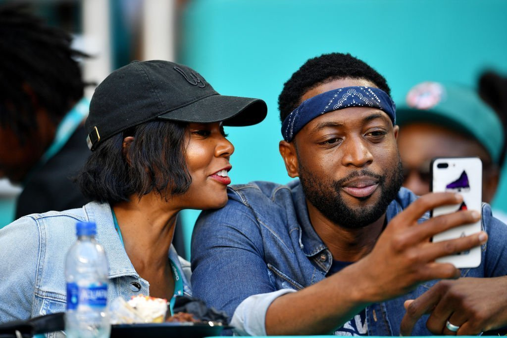Dwyane Wade of the Miami Heat and wife and actress Gabrielle Union attend the game between the Miami Dolphins and Chicago Bears at Hard Rock Stadium in Miami, Florida | Photo: Getty Images