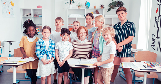 Daily Joke: Teacher Who's Persuading Kids to Buy Their Group Photo Gets an Honest Response