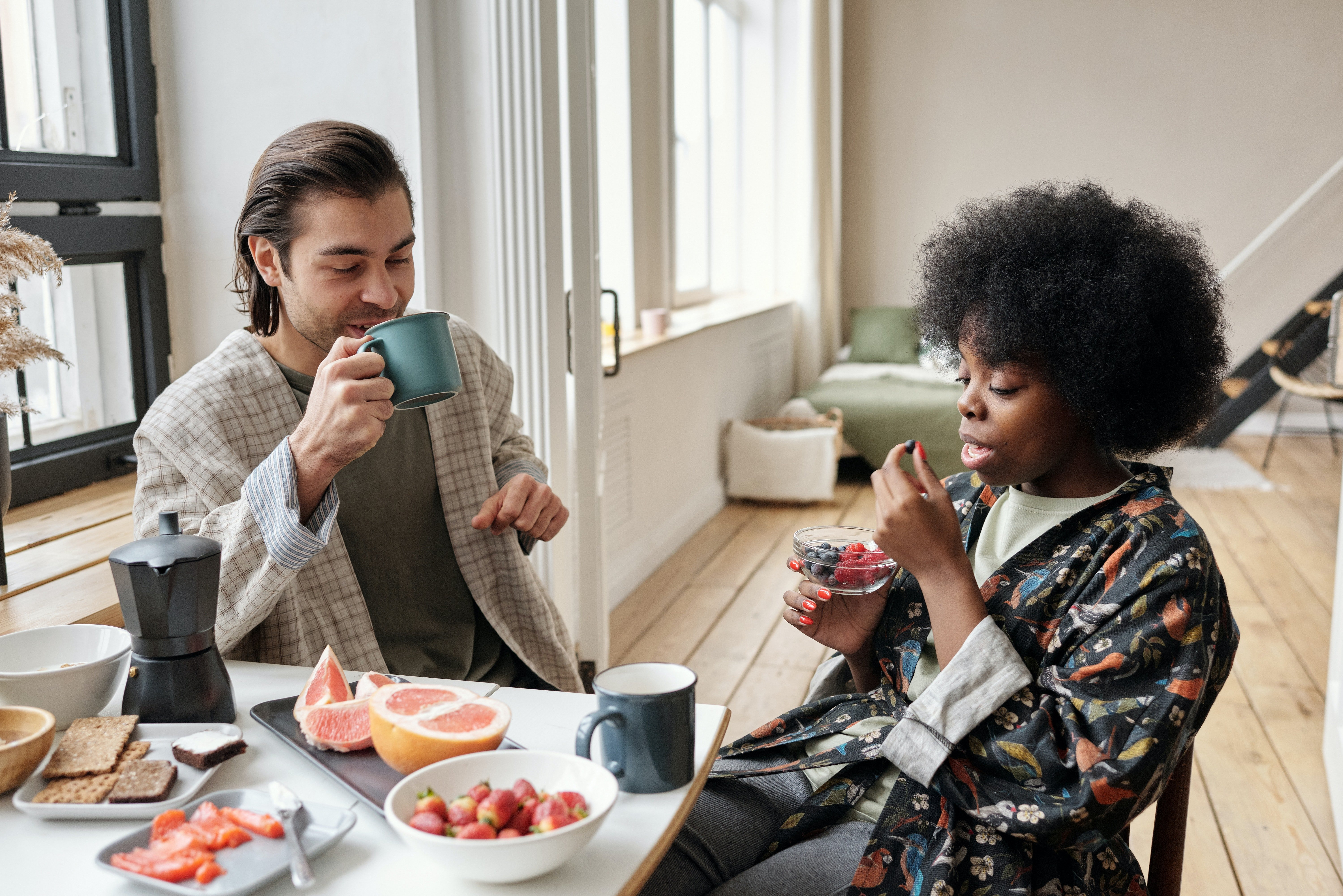 A man and woman drinking tea together.   Pexels/ Jack Sparrow