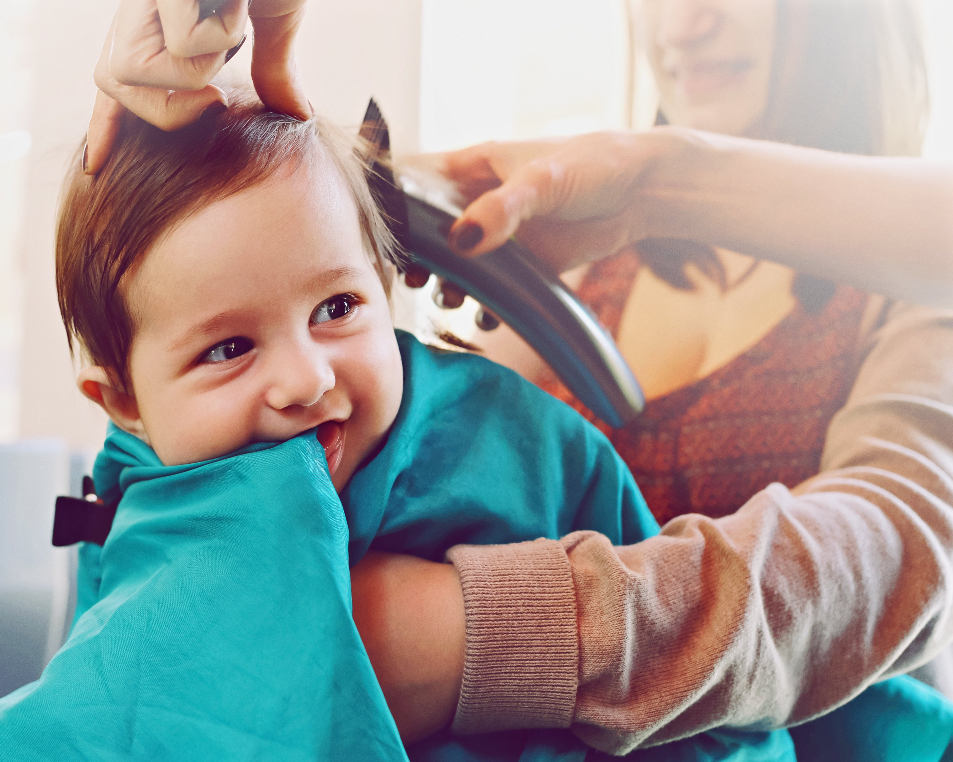 Baby sitting at the hair salon, | Photo: Getty Images