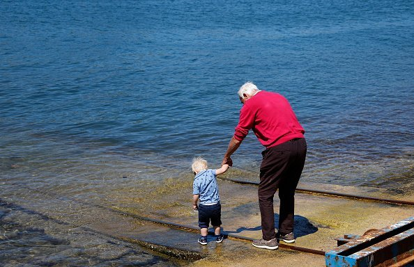 Photo of a Grandpa and his Grandson having a good time | Photo: Getty Images