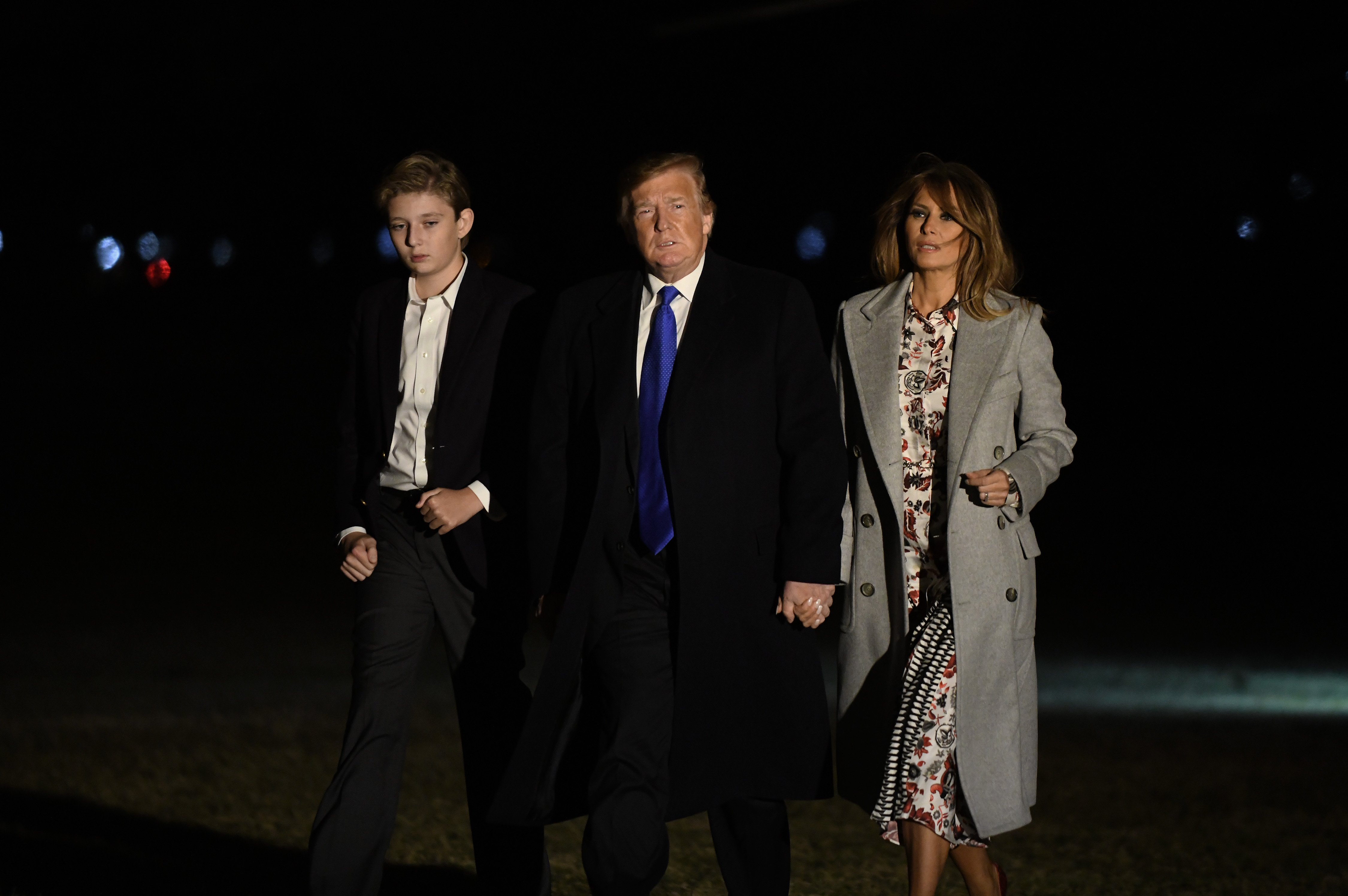 President Donald Trump and First Lady Melania with their son Baron on the grounds of the White House | Photo: Getty Images