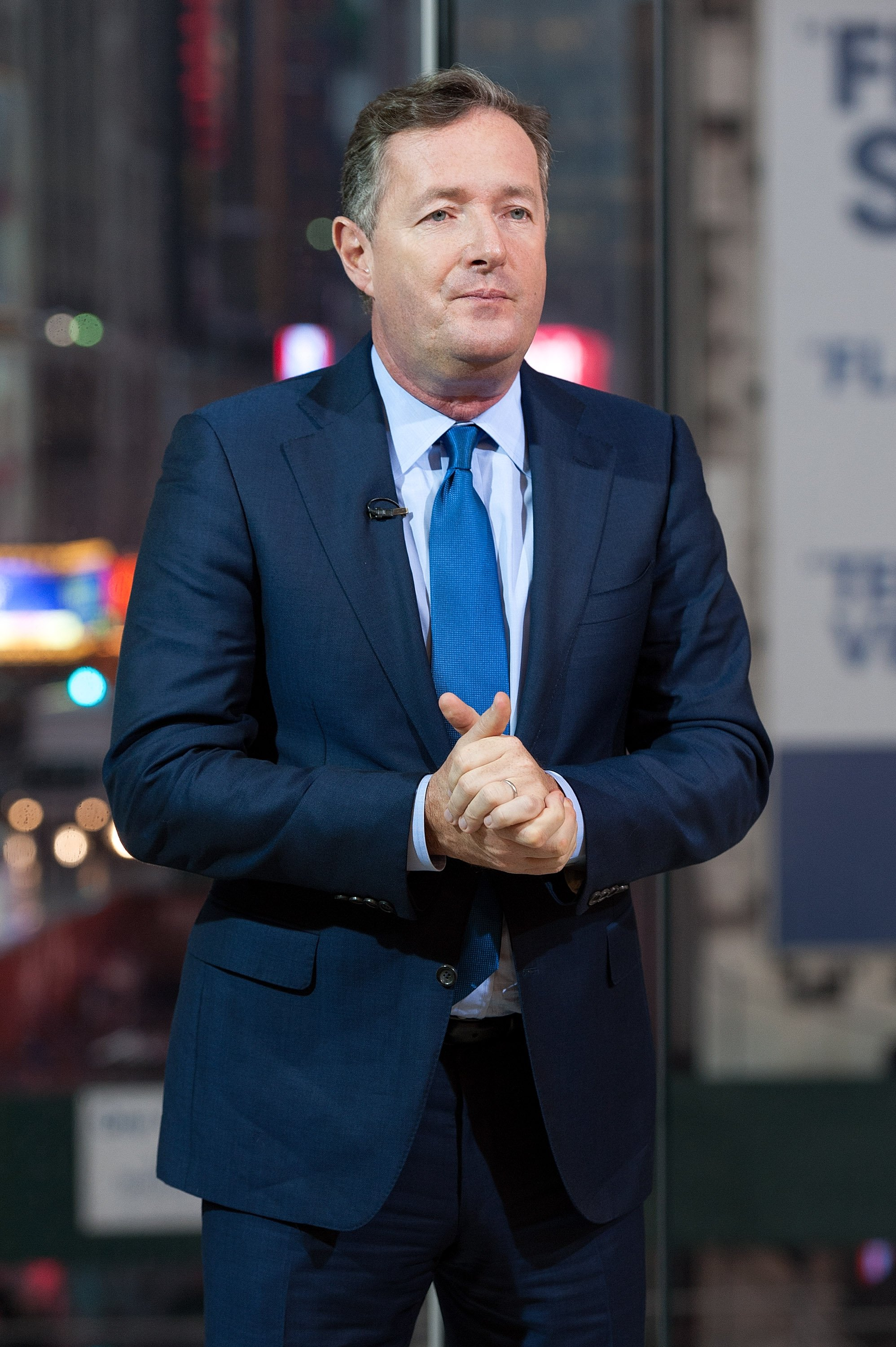 "Piers Morgan pictured on set at the ""Extra"" studio in New York City. 2014. 