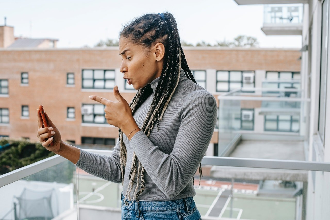 Angry woman talking on video call   Source: Pexels