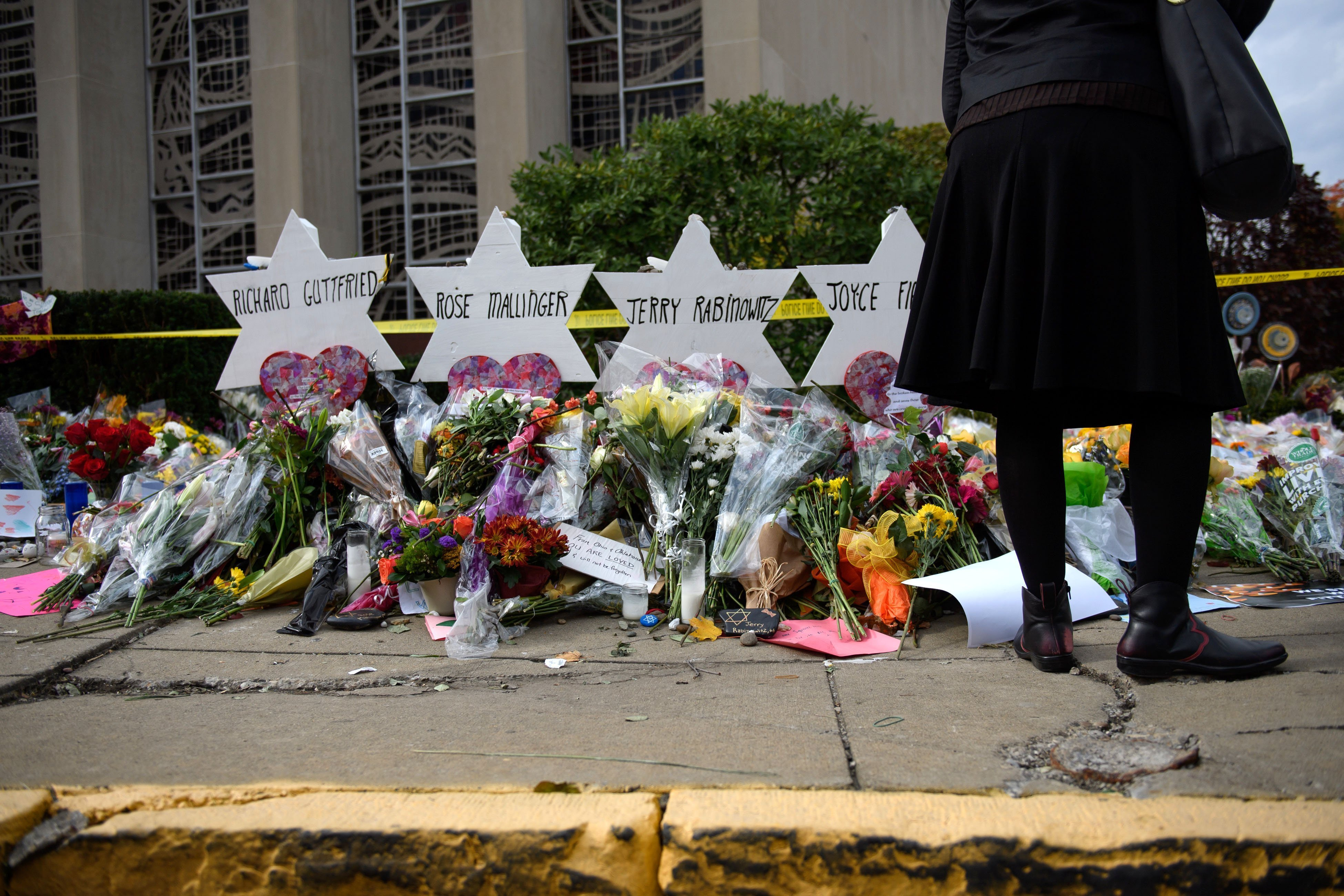 Flowers in memory of those who perished in the Pittsburgh shooting - Getty Images