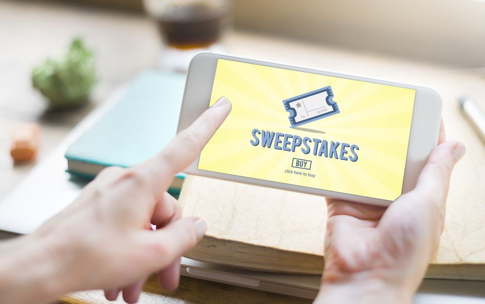 An online sweepstakes application open on a phone. | Source: Shutterstock