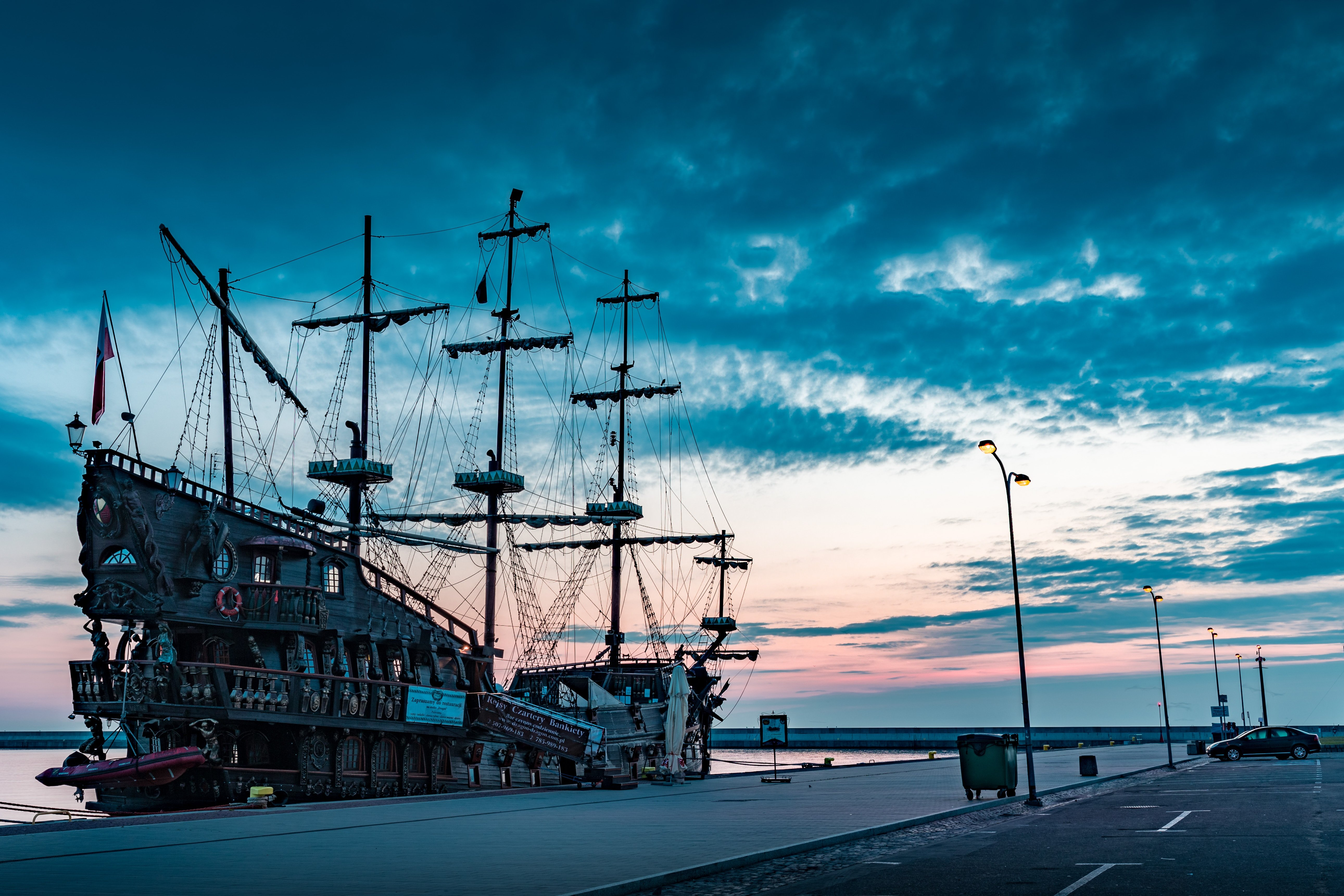 A galleon ship anchored at the dock | Source: Unsplash.com