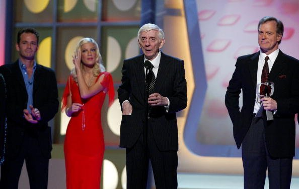 Luke Perry, Tori Spelling, Aaron Spelling, and Stephen Collins onstage at the 2005 TV Land Awards at Barker Hangar on March 13, 2005 in Santa Monica, California. | Photo: Getty Images