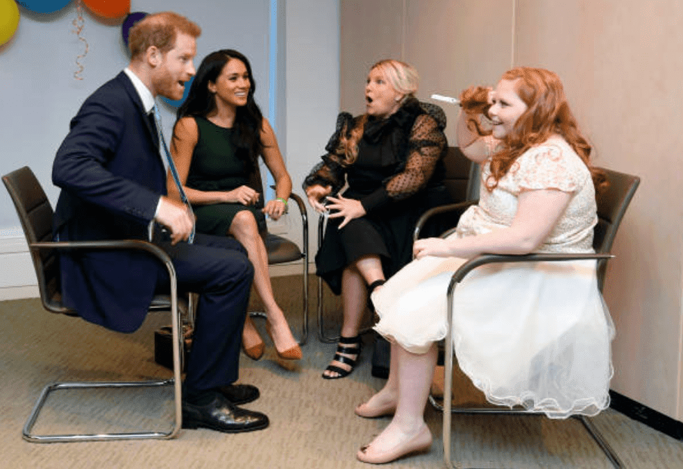 Prince Harry and Meghan Markle chats with award recipient Milly Sutherland and her mother, Angela Sutherland at the WellChild awards pre-Ceremony reception, on October 15, 2019 in London, England | Source: Toby Melville - WPA Pool/Getty Images