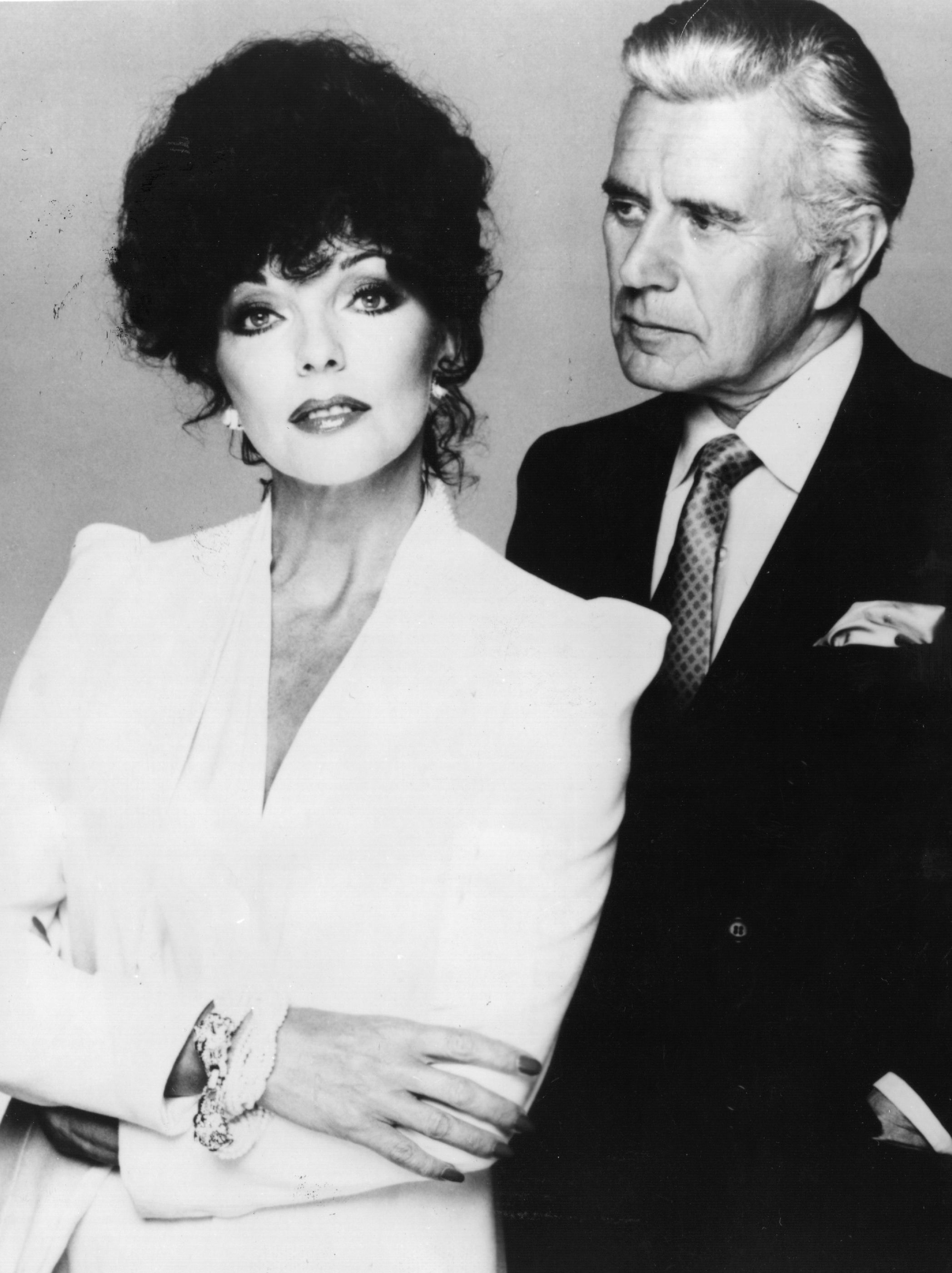 British actress Joan Collins and her 'Dynasty' TV series co-star John Forsythe | Photo: GettyImages