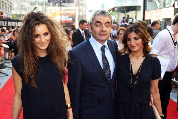 Lily Atkinson, actor Rowan Atkinson and Sunetra Sastry attend the UK premiere of Johnny English Reborn | Photo: Dave Hogan/Getty Images
