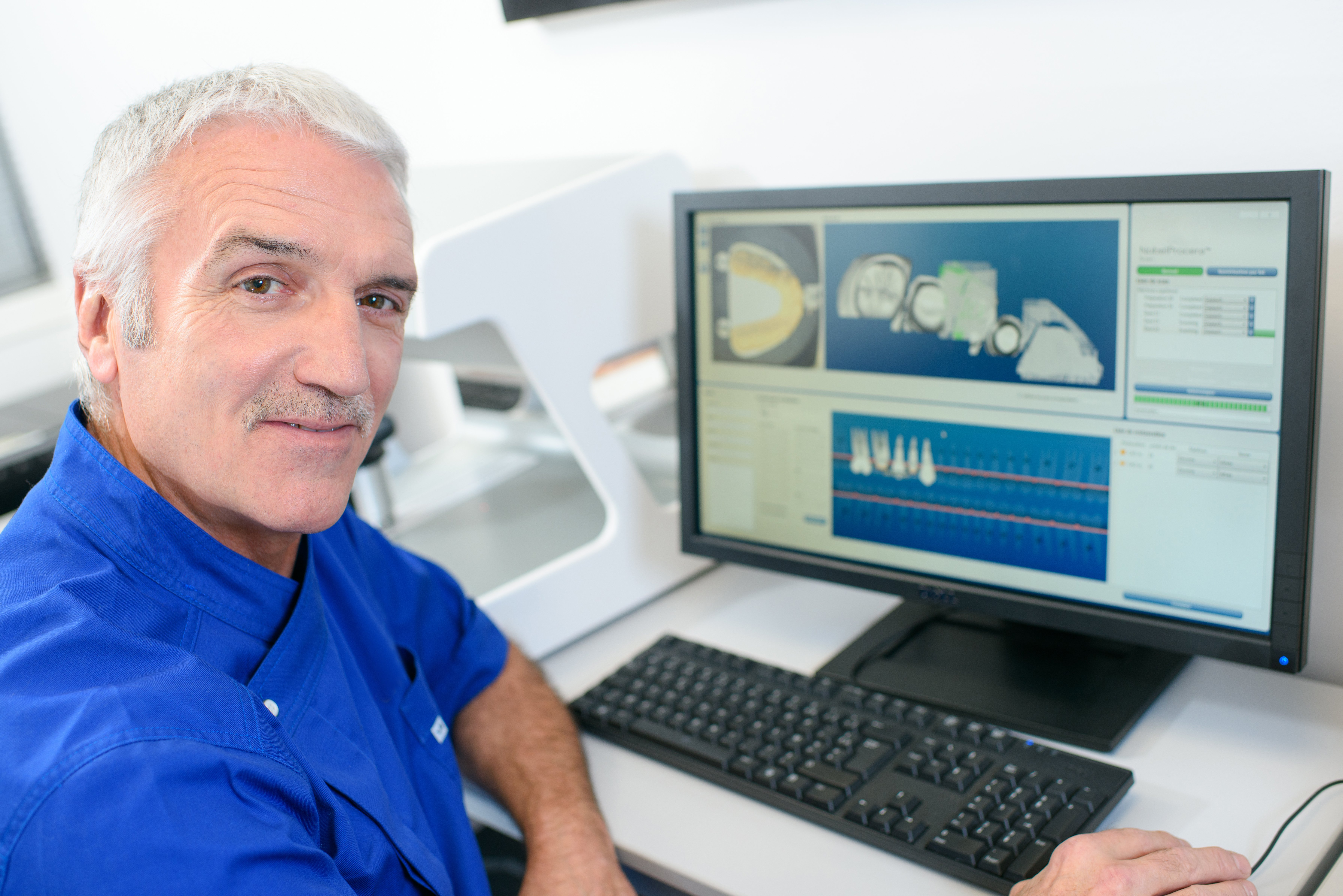 Dentist sitting in front of his computer | Photo: Shutterstock
