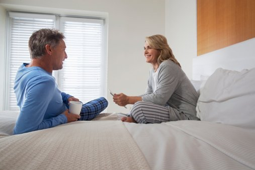 Middle age couple pictured having a talk in the bedroom |  Photo: Getty Images