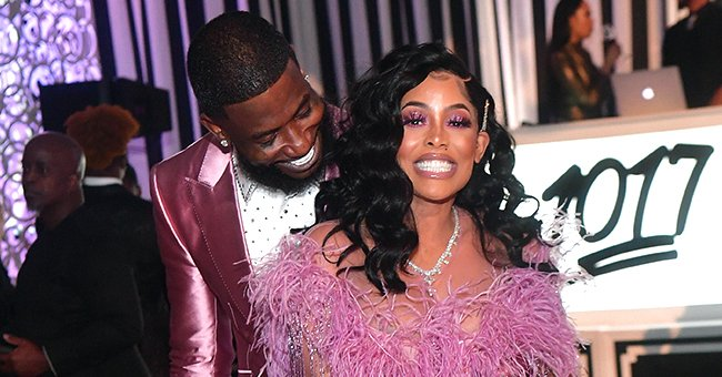 Gucci Mane's Wife Keyshia Ka'oir Flaunts Her Baby Bump in a Red Jumpsuit & Matching High Heels
