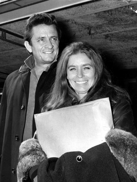 Johnny Cash and his wife June Carter Cash of the Carter Family group arrive May 1, 1968 at London Airport | Photo: Getty Images