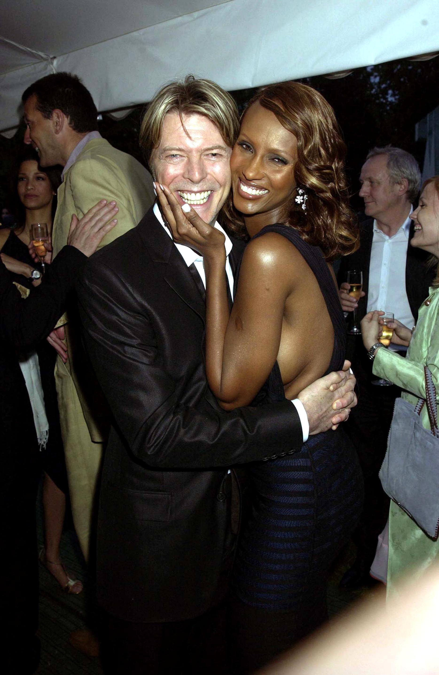 Iman and David Bowie pose sweetly at the Serpentine Gallery Summer Party in London on July 09, 2002. | Source: Getty Images
