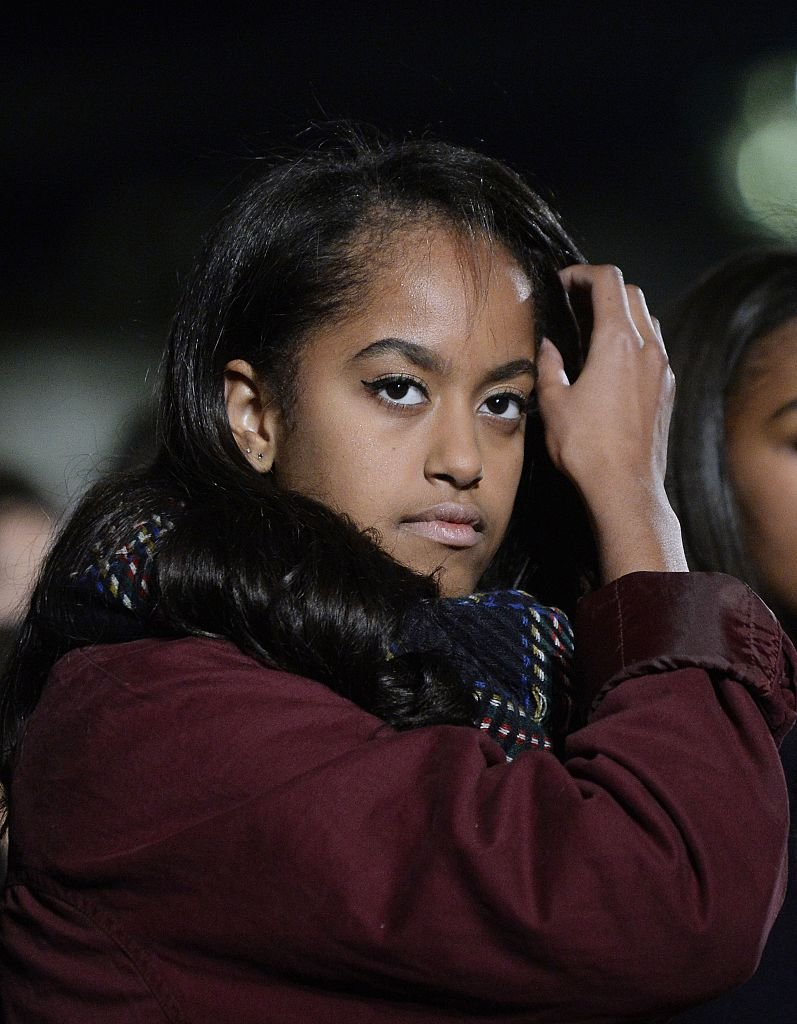 Malia Obama attends the national Christmas tree lighting ceremony on the Ellipse south of the White House   Photo: Getty Images