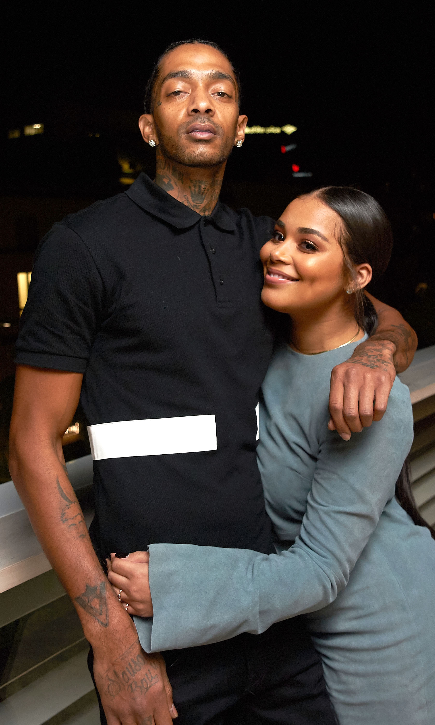 Nipsey Hussle & partner Lauren London at a party on Nov. 4, 2016 in California | Photo: Getty Images