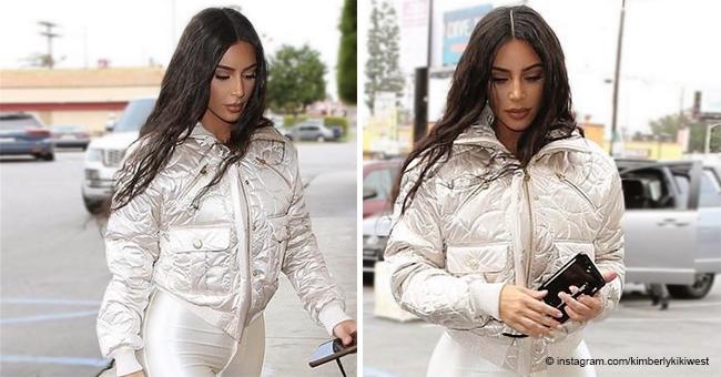 Kim Kardashian Dons Eye-Popping Shiny White Leggings and Puffer Jacket While in Calabasas
