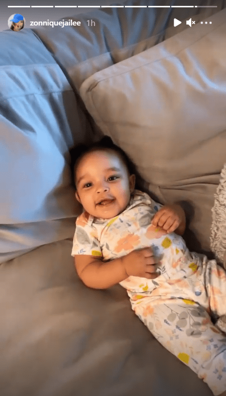 Zonnique Pullins shares a picture of her daughter smiling in bed.   Photo: Instagram.com/Zonniquejailee