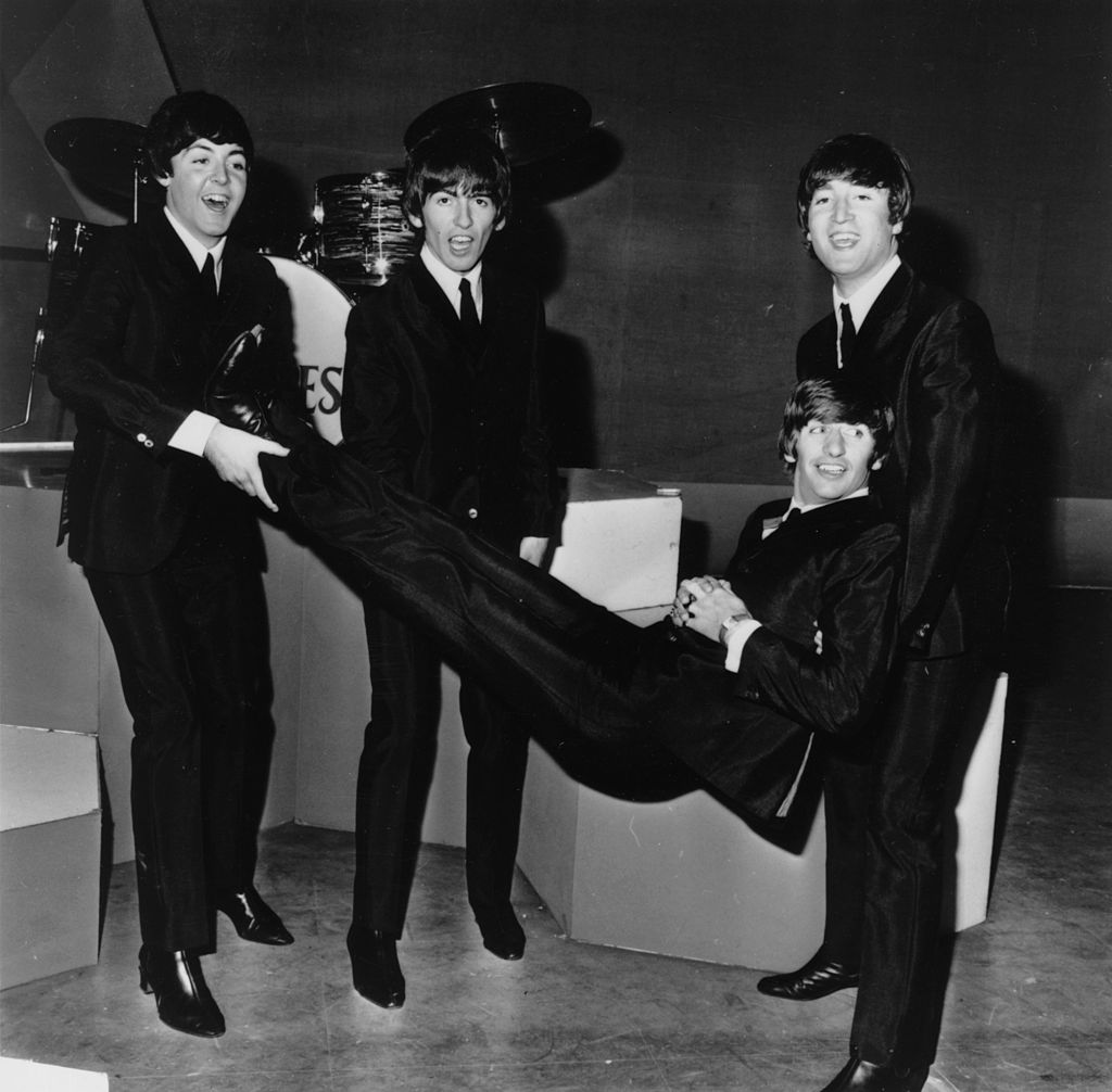 Ringo Starr being given the bumps by the other members of popular rock group The Beatles on his 24th birthday. | Getty Images / Global Images Ukraine