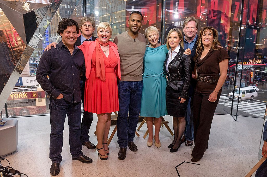 """AJ Calloway with Matthew Labyorteaux, Michael Landon, Jr., Alison Arngrim, Karen Grassle, Melissa Sue Anderson, Dean Butler, and Lindsay Greenbush of """"Little House On The Prairie"""" during their visit to """"Extra"""" on April 30, 2014   Photo: Getty Images"""