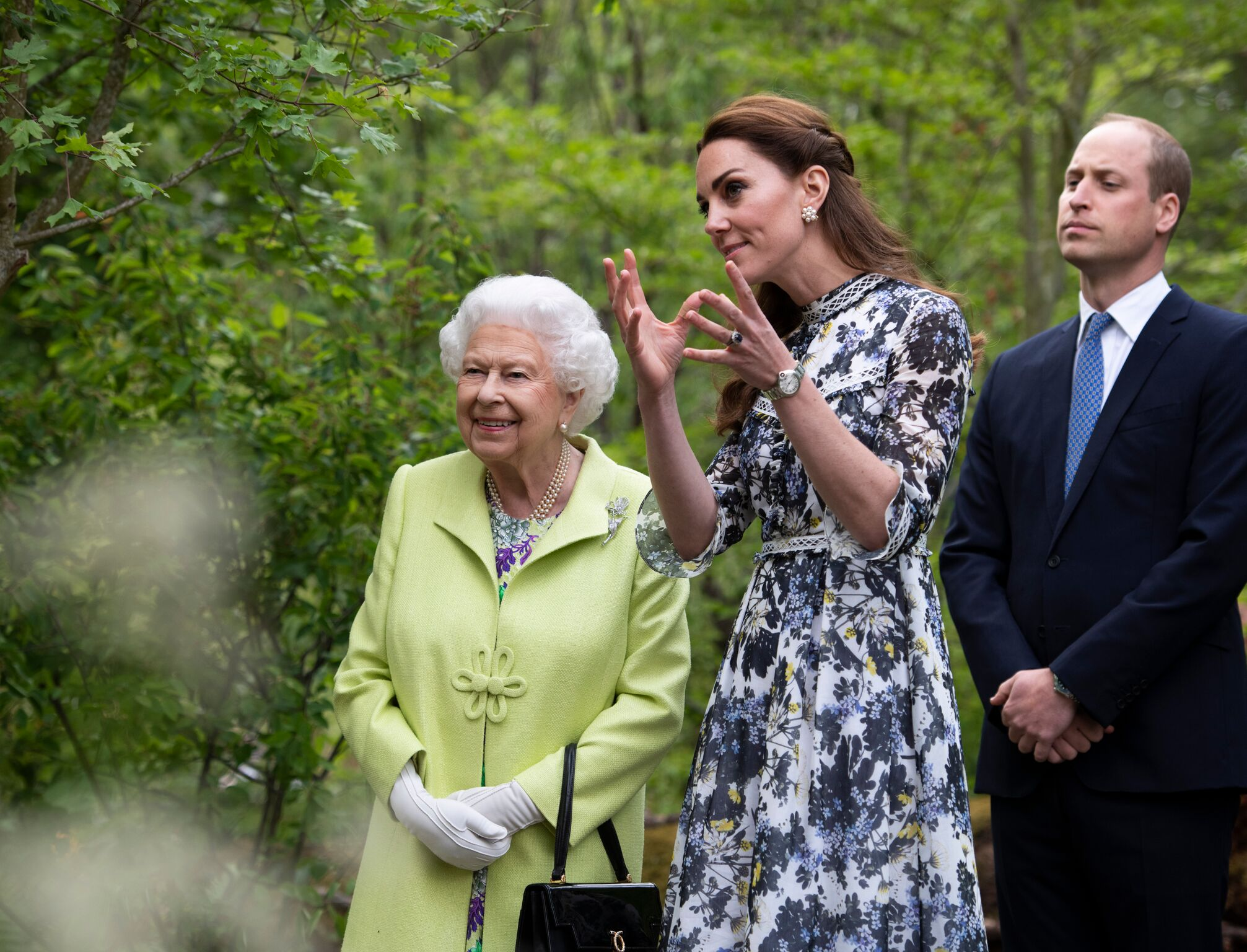 Queen Elizabeth II is shown around 'Back to Nature' by Prince William and Catherine, Duchess of Cambridge | Getty Images