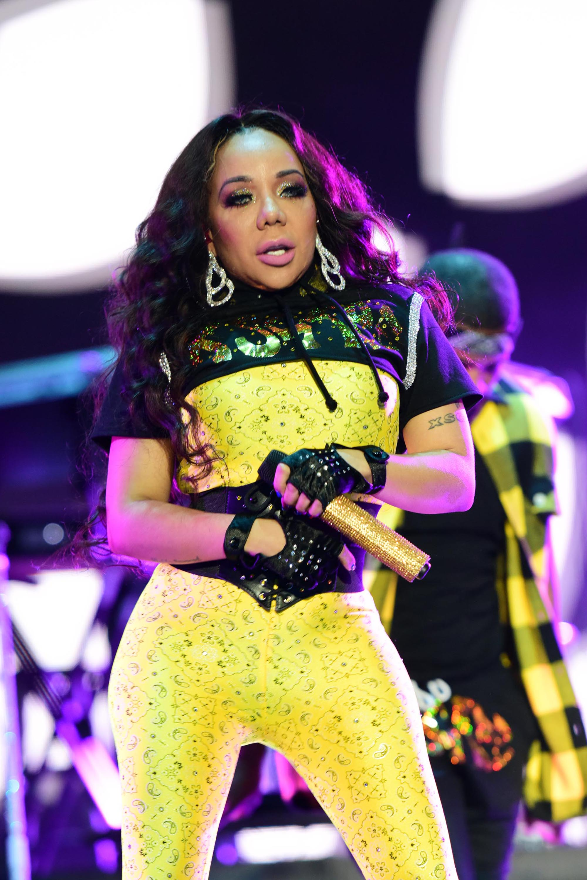 """Tameka """"Tiny"""" Harris performs at the 2018 Essence Festival on July 7, 2018. 