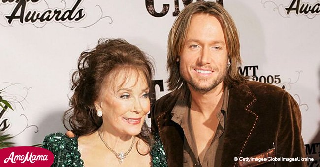 Loretta Lynn wants Keith Urban to jump out of her birthday cake, and his response is pure gold