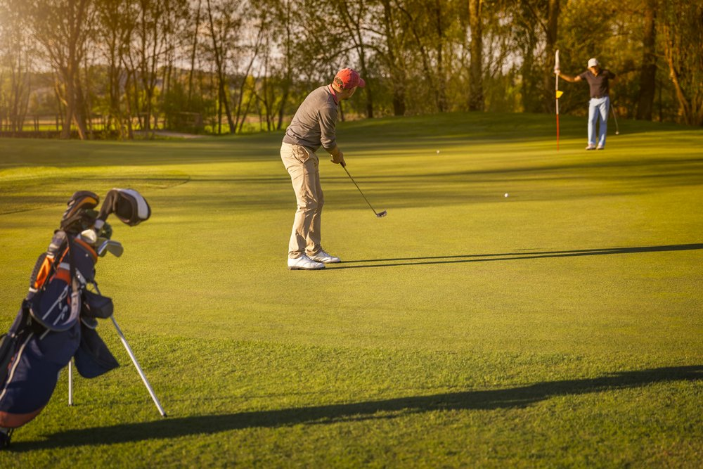 A photo of two people playing golf   Photo: Shutterstock