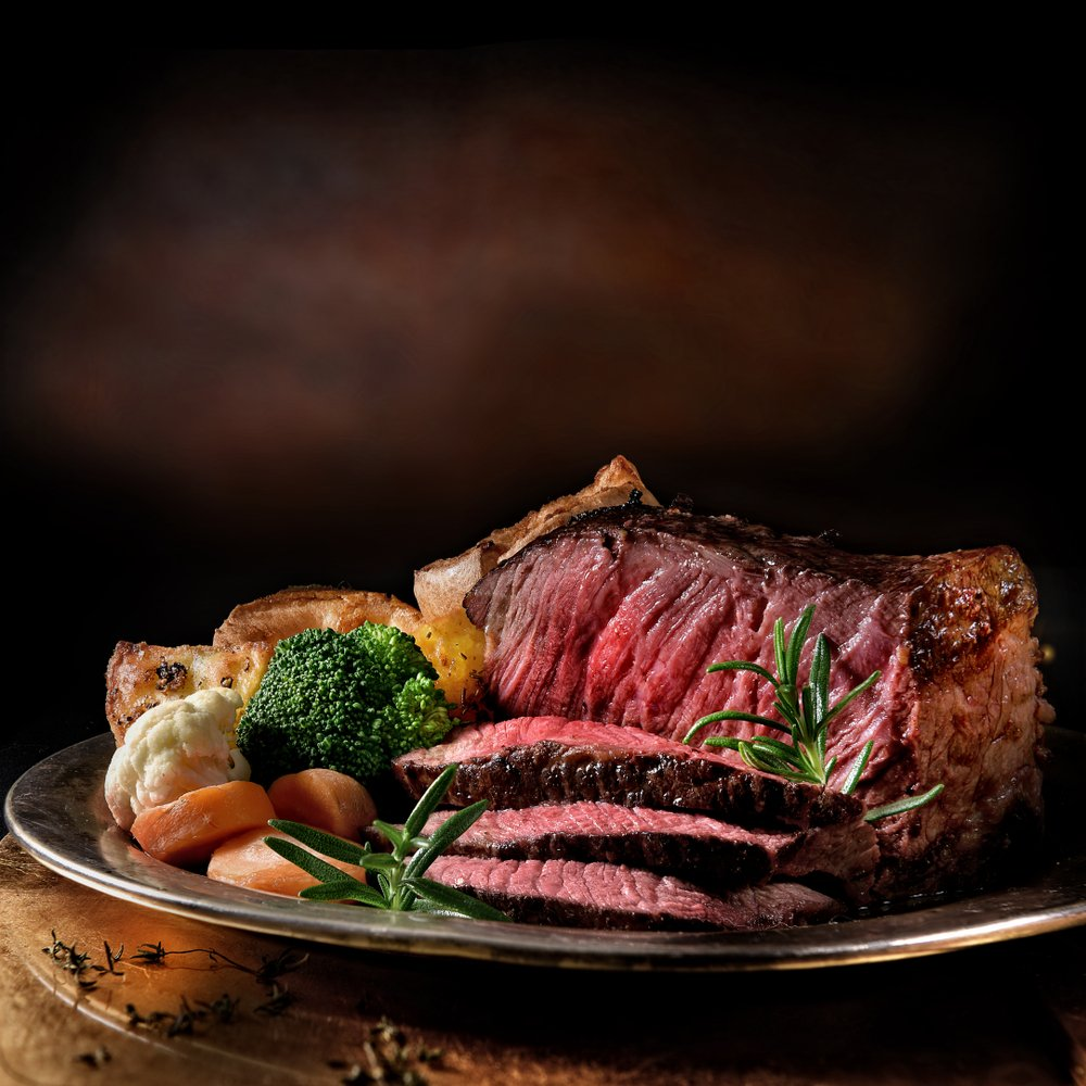 Rare roast beef meal with organic root vegetables with roasted potatoes. | Photo: Shutterstock.