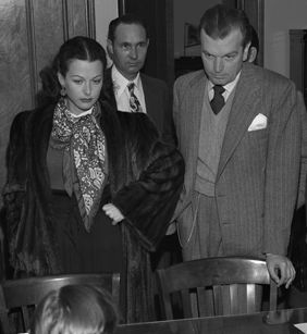 Hedy LaMarr and John Loder in courtroom, confronting men suspected of robbing their house in Los Angeles. | Source: Getty Images