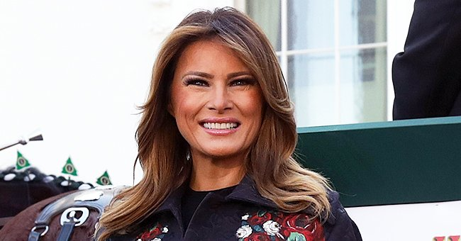 Melania Trump Stuns in Floral Dolce & Gabbana Coat and Stiletto Boots to Receive Christmas Tree at The White House