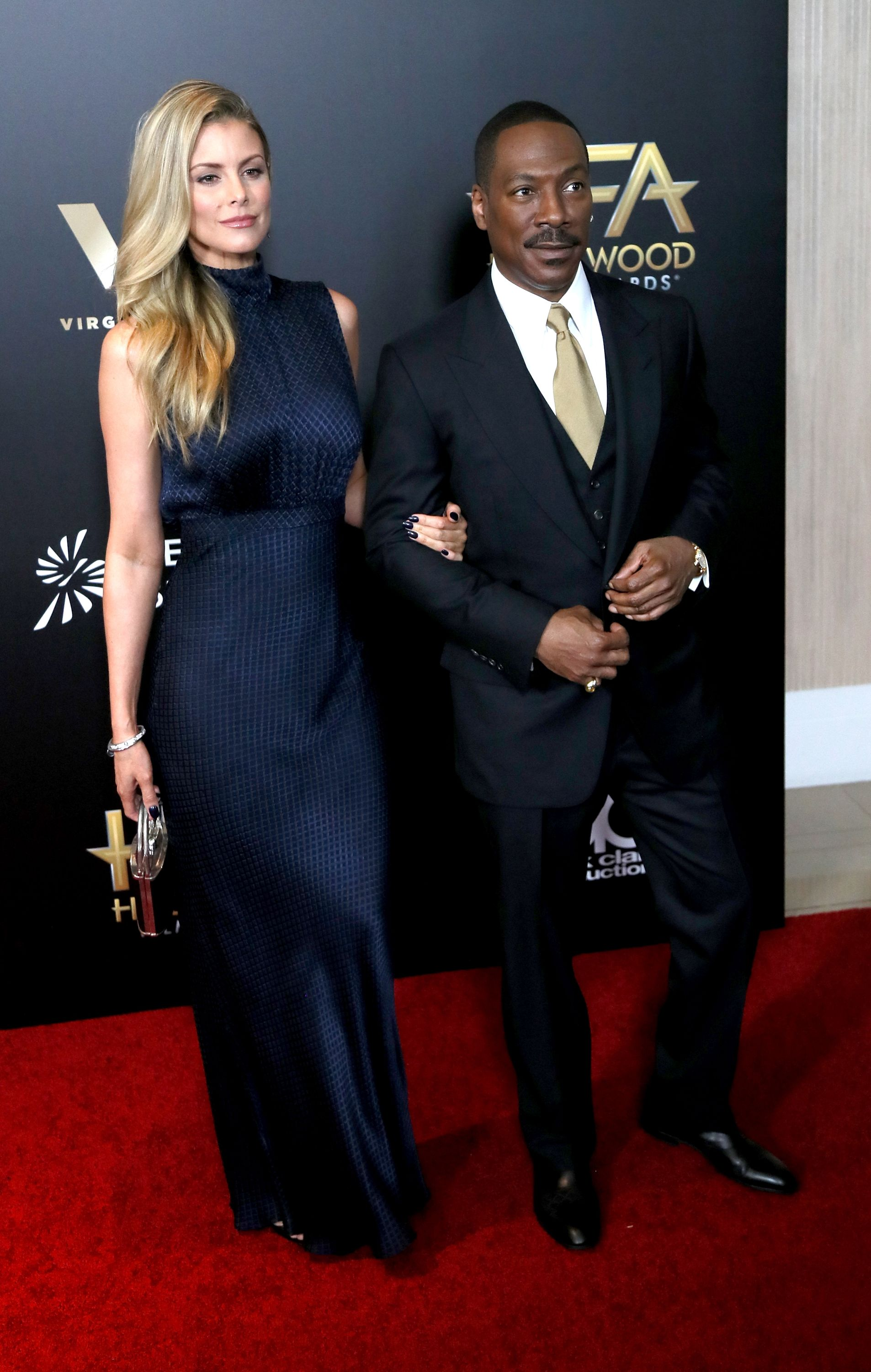 Eddie Murphy and Paige Butcher at the 20th Annual Hollywood Film Awards in 2016 in Beverly Hills | Source: Getty Images