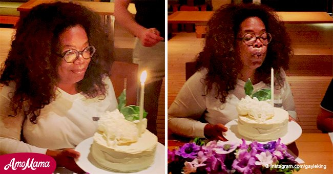 Oprah celebrates 65th birthday aboard $300M yacht blowing out a candle on a 'delish' cake